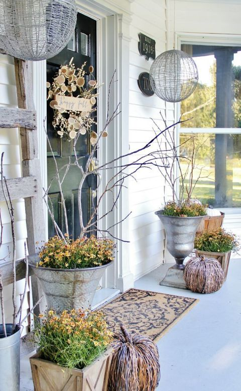 "A ""Happy Fall"" wreath made of wood slices and twigs turns your front door into a beautiful fall entrance. 