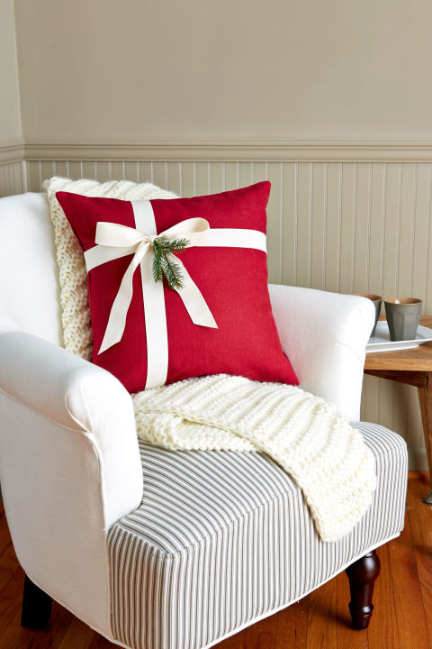 Take a plain pillow from ho-hum to ho-ho-ho by simply wrapping it like a present. (Yes, it's that simple.) Add a sprig of greenery or a festive ornament for an extra bit of flourish.  What you'll need: red pillow ($17,target.com);white ribbon ($9,amazon.com)
