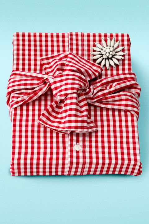 Infuse new life into a thrift-store shirt and brooch. Not only is the result eco-friendly, but, as gift wrap designer Jenn Playford points out, when you remove the brooch and unpin the shirt, you've got three gifts in one.