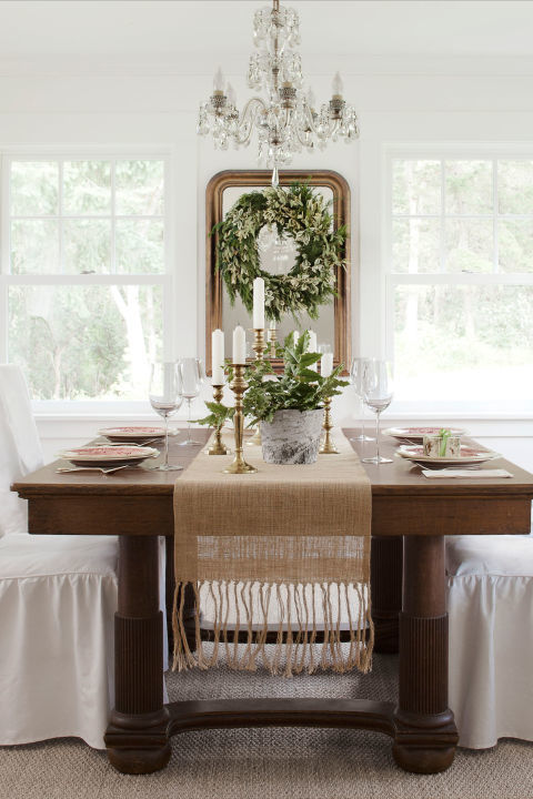 A Pottery Barn runner and Target slipcovers lighten up the heavy oak dining-room set that once belonged to Trina's great-great grandparents. Bright idea: Turn a wreath into a framed work of art by hanging it atop a mirror.