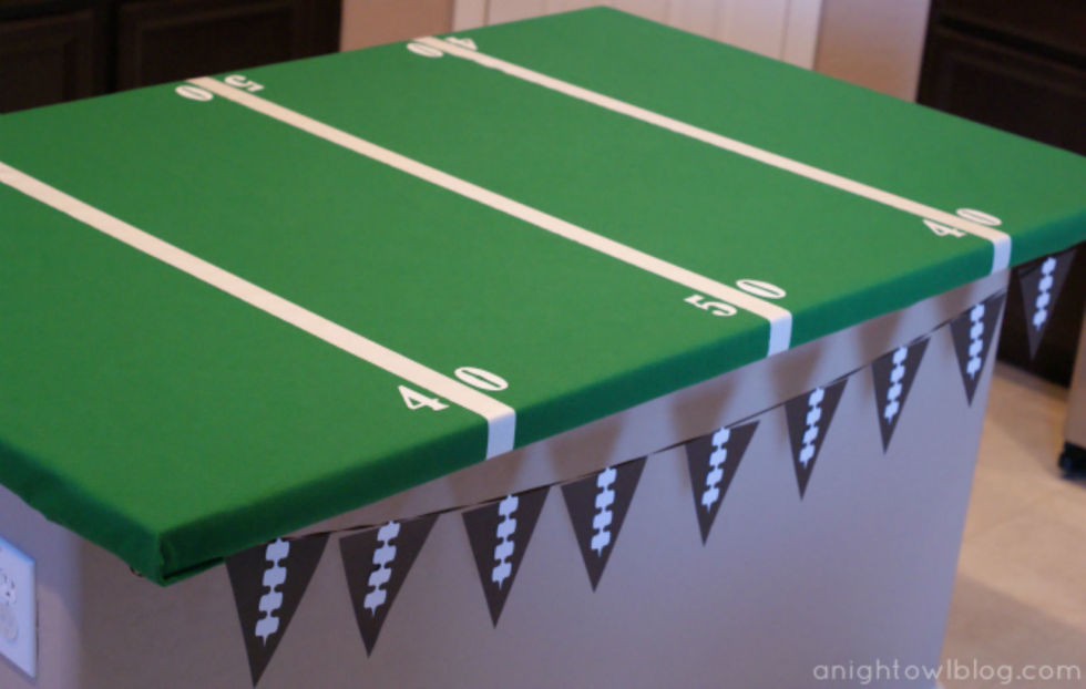 Dress up you Super Bowl snack table with this table cover inspired by the gridiron. Not only is it cute, it makes clean up super easy!