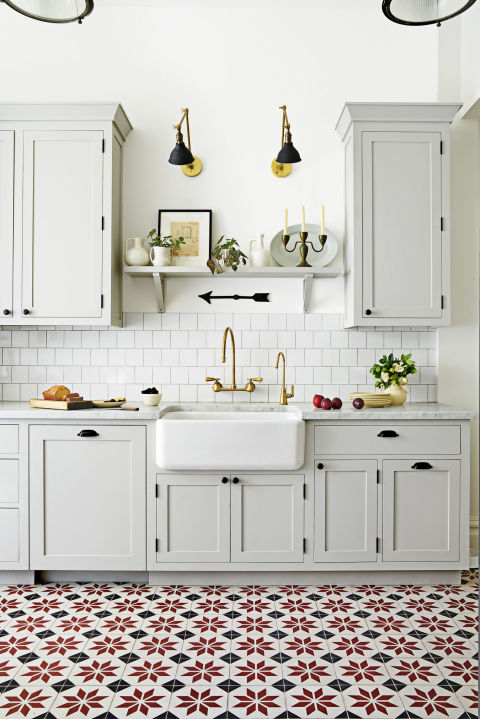 Rugs, however durable, aren't practical for a heavy-use kitchen. Enter statement floor tile. It's a more subtle way to add impact than, say, a bold eye-level backsplash (go to granadatile.com for similar quilt-like patterns).