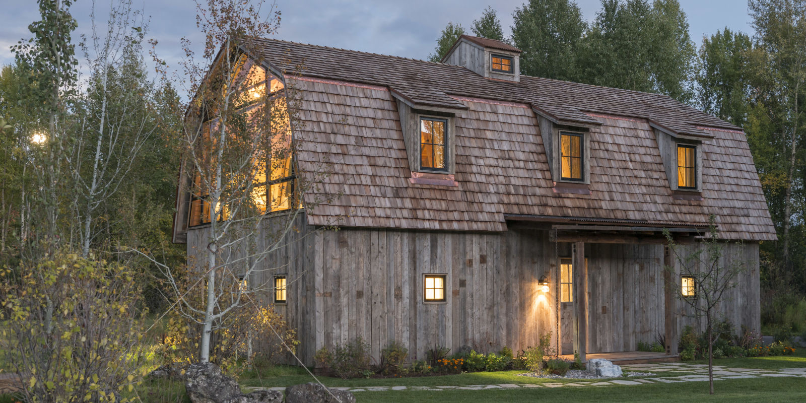 This guest house was built to look like a rustic barn for Homes with barns