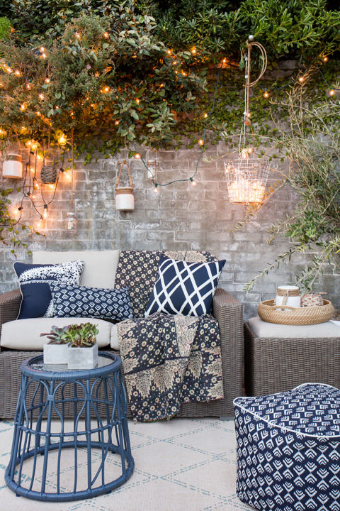 String Lights Donu0027t Always Have To Steal The Show. Draping Them Across Some  Plants Or A Wall Adds A Lovely But Subtle Background Touch To Your Outdoor  ...