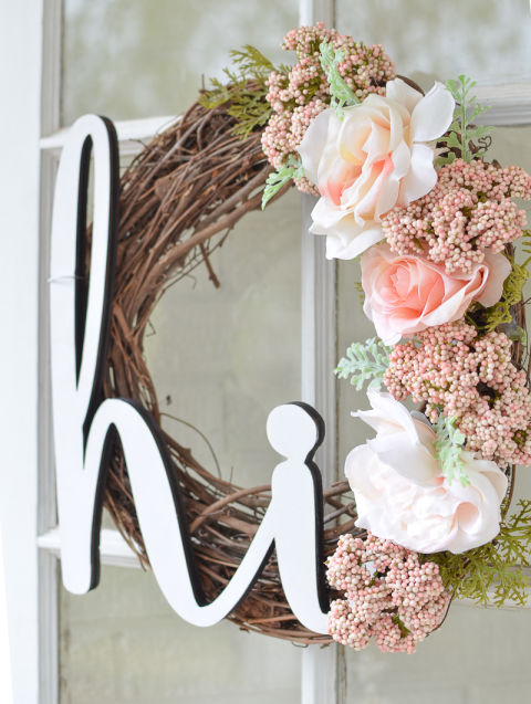 Add wooden cutout words or initials to your wreath for a personalized touch. Get the tutorial at Little Vintage Nest.
