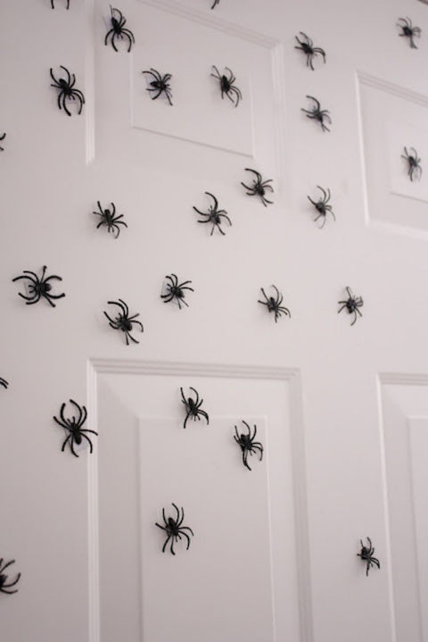 Decorate your walls with lots of eight-legged arachnids. You'll need some plastic dollar store spider rings, magnet sheets, scissors, and a hot glue gun.