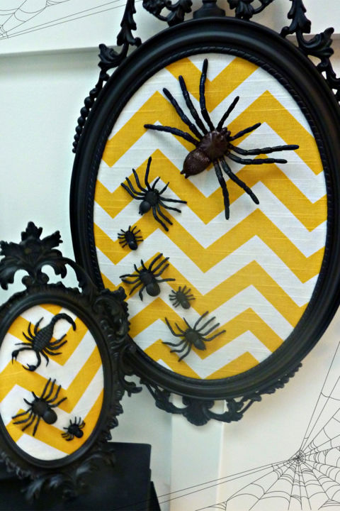 Put a spooky twist on a classic pattern. Get the tutorial at The Happy Housie.  What you'll need: vintage frames (from $13; amazon.com), chevron fabric ($5 per yard; amazon.com), plastic spiders ($7; amazon.com), black spray paint ($4; amazon.com), Mod Podge ($6; amazon.com)