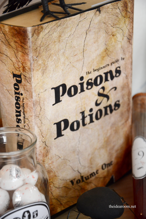 Spook your guests by hiding this potions book in plain sight! Get the tutorial at The Idea Room. What you'll need: old books, glue ($2 for 4;amazon.com), printable cover (theidearoom.net)
