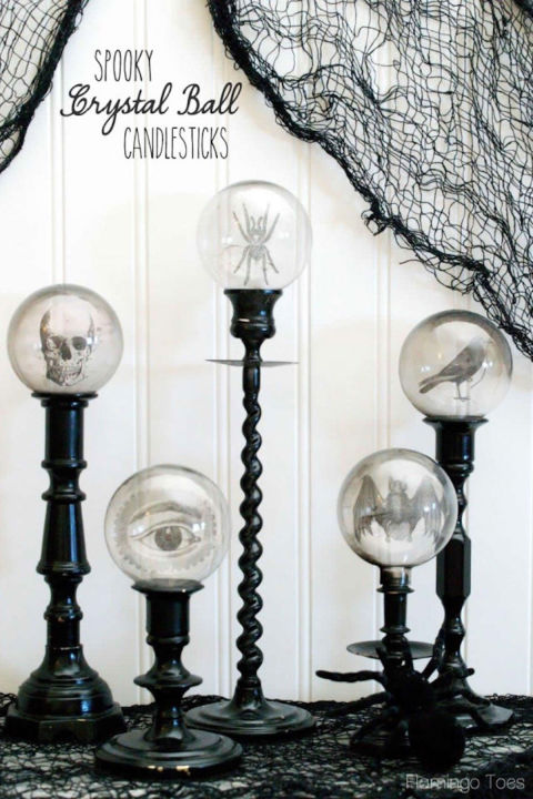 This craft makes it look like eyes, skulls, and spiders are floating—and it's magically easy to make. Get the tutorial at Flamingo Toes.  What you'll need: inkjet transparency film ($6; amazon.com), candlestick holders ($20 for 2; amazon.com), clear bulbs ($8 for 6; amazon.com)