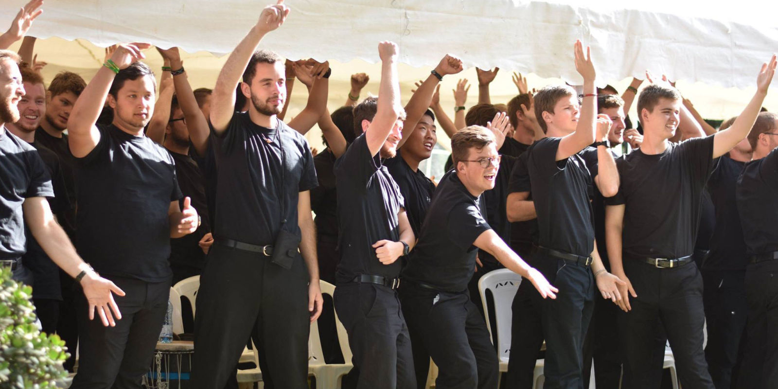 This Men's Choir Broke Into Full Song and Dance on an Airplane and It Was Hilarious