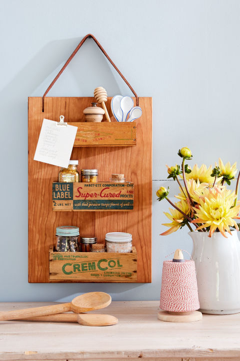 Repurpose an old cutting board by using screws to attach small wooden cheese boxes to a rectangular cutting board. Then add a leather strap for hanging. What you'll need: vintage wooden cheese boxes (from $11, etsy.com)