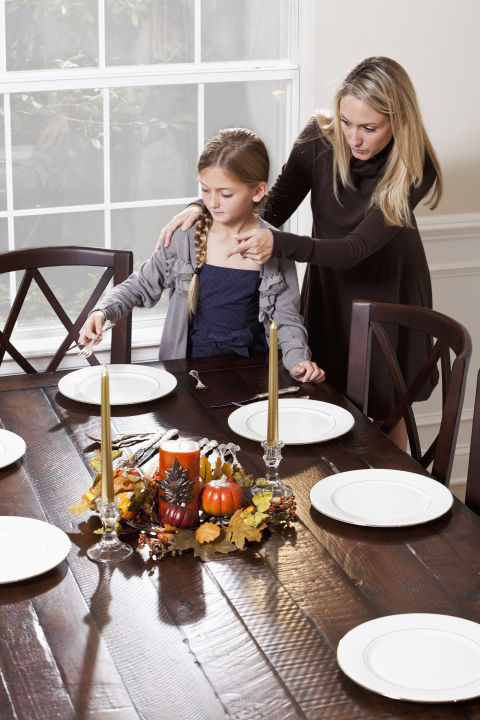 Not only does setting the table give your kids a sense of responsibility and a role in helping with the Thanksgiving meal, but it's also something special to share each year.