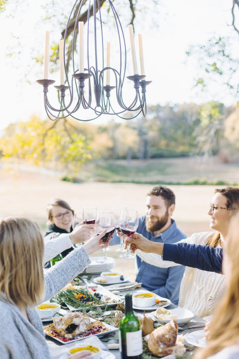 Even if you don't pray before your Thanksgiving meal, make it a tradition to go around the table and have everyone say what he or she is thankful for. At the end, raise a glass to toast to food, family, friends, and fun.