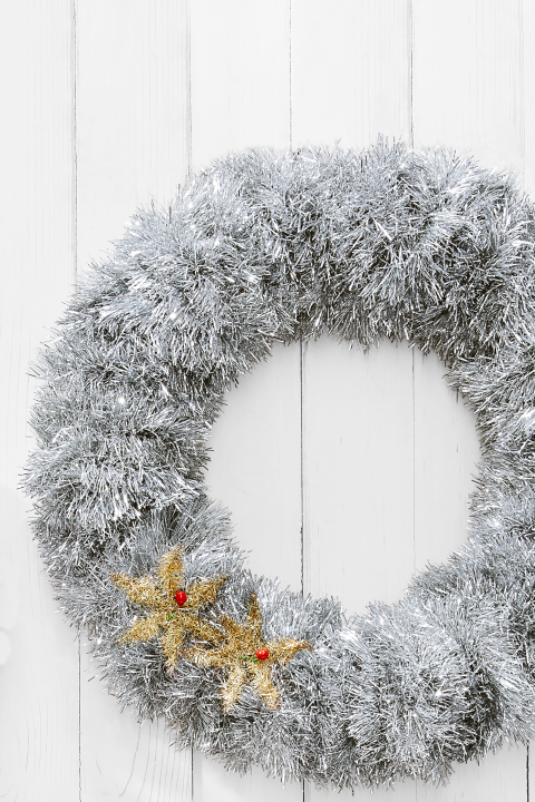 Wrap a 16-inch Styrofoam wreath form with tinsel, using U-shaped wire greening pins to secure ends. What you'll need:16-inch styrofoam wreath form ($10,amazon.com); tinsel garland ($9, amazon.com)