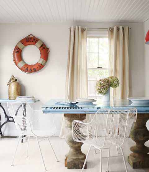 The dining table in this Hamptons cottage is a true showstopper thanks to its upcycled circa 1800s corbels and blue shutters. Topped with a sheet of glass (cut with smooth, rounded edges), the sturdy combo anchors the eating area with memorable, one-of-a-kind style.