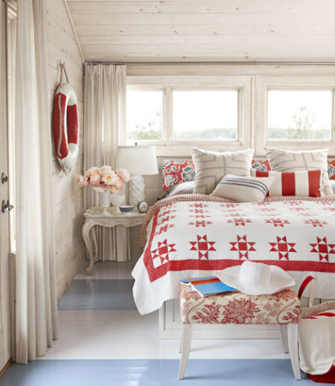 Designer Sarah Richardson decorated this master bedroom from her summer cottage in red and white, adding liberal hues of blue.