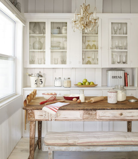 4. Pull up a bench. This backless number offers equal seating to a host of chairs but can be tucked under the table when not in use (and doesn't block the view of the butler's pantry). For extra storage, slots carved into the farm table store spoons. RELATED: 64 Impressive Dining Rooms