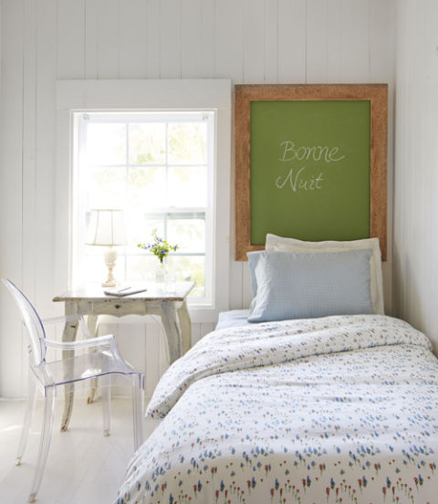 "12. Skip a traditional headboard. With not an inch to spare, Fifi pushed the guest room's twin bed against the wall and hung a green chalkboard in place of a headboard. Bonus: The piece doubles as a memo board. 13. Don't shy away from lucite. At first glance, translucent furniture like this Louis ""ghost"" chair might seem too sleek for Fifi's quaint style. But by taking up less visual space, it helps weathered pieces like the desk-turned-nightstand shine and prevents the tight quarters from feeling cramped."