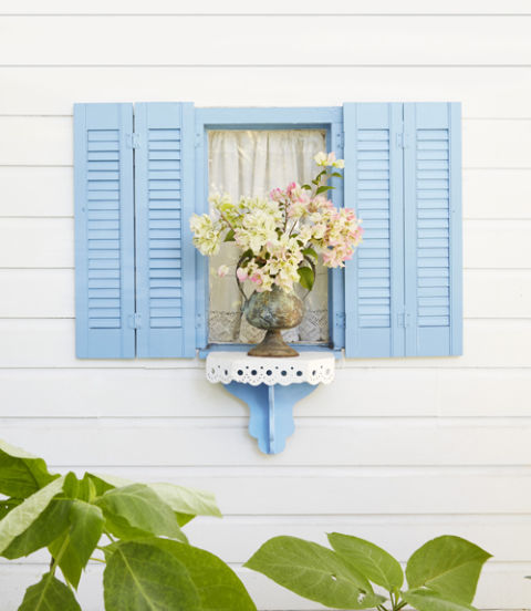16. Add pops of color. A thrift store ledge painted to match the home's cheery blue trim stands in for a window box below this 13-inch-wide window. RELATED: Our Favorite Tiny Homes