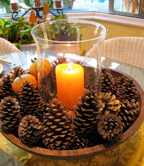 Need a centerpiece that takes less than five minutes to make? Just place pine cones in a large bowl and place a hurricane vase holding a candle in the middle. Get the tutorial at May Days. RELATED: 15 Beautiful Fall Centerpieces