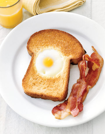 This hole-in-one beauty begins with a thick slice of buttered brioche bread. The freshest eggs will have centered, golden yolks and the best flavor. Drop in a jumbo egg and cook until the bread is toasted and the egg is set. Pair with bacon or roasted tomatoes. Recipe: Egg-in-the-Hole