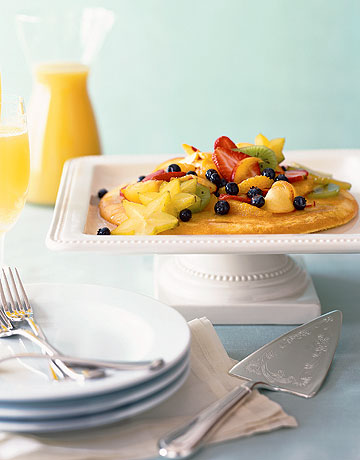 Fluffed and puffed up with the leavening power of farm-fresh eggs, this lightly sweetened omelet-like pancake for two is topped with cardamom-scented tropical-fruit salad. Recipe: Puffed Pancake with Cardamom-Fruit Salad
