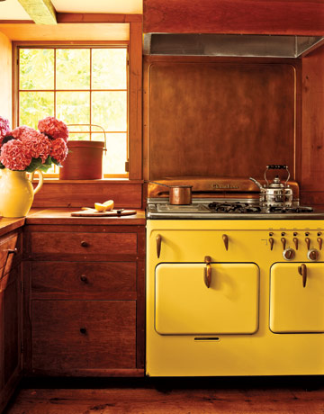 wood kitchen with antique yellow stove