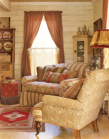neutral and red toned chairs in a sitting area near window with