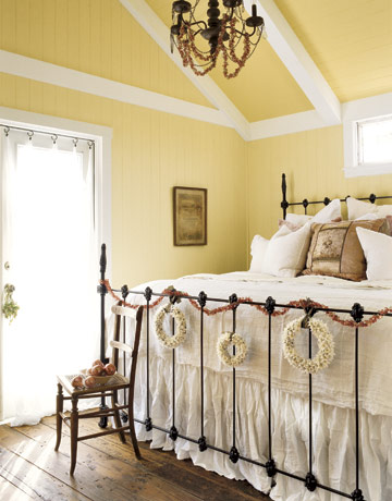 in the andereggs 39 sun washed bedroom a gracious iron bed is dressed