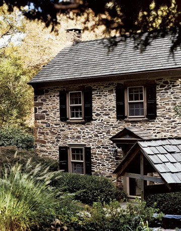 An outdoor gathering in the country for Fieldstone houses