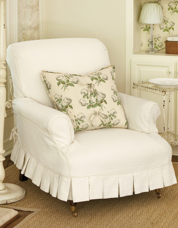 white chair with slipcover with pleated edge