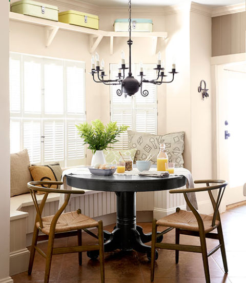 A coat of paint (Beluga by Behr) refreshed this Texas ranch's flea-market table. The owner's mom brought the 1950s Hans Wegner chairs when she moved in earlier this year.<br /> Bright idea: Vintage breadboxes provide sneaky storage for table linens.<br />
