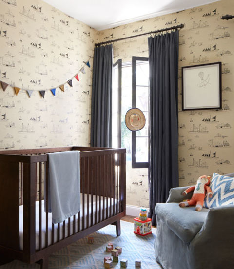This nautical wall covering, which features line drawings of sailing ships is at once very little boy and oh-so grown up. Thanks to the room's sophisticated color foundation of cream and brown-black, the decor will have life beyond the baby years. Swaths of solid blue linen (on the glider and the curtains) envelop the space in soothing, masculine shades. The strand of alpaca wool bunting finishes off the serene space with a playful note in this California bungalow.</p> <p>  Amazing Kids&#8217; Rooms ideas 54eb02619fa63   country strong nursery 1114 xln