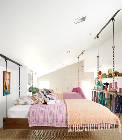 Ree Drummond—also known as The Pioneer Woman—transformed her family's attic into a bedroom for her daughters in a style that's a little bit country, a little bit rock 'n' roll. She bypassed typical tween motifs in favor of sophisticated separates, including crisp white sheets and blankets in fresh cranberry and tangerine hues. Quirky throw pillows pile on extra charm.<br /> See the complete makeover »<br />   Amazing Kids&#8217; Rooms ideas 54eb0267a6eeb   hanging bed kids bedroom makeover 0612 ncjlzd xln
