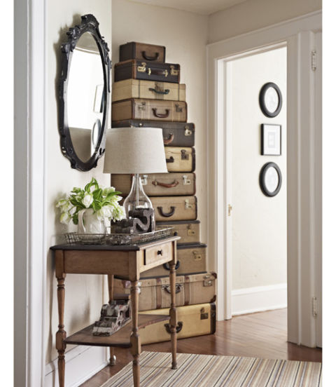 """Put treasures to work. Stacked up, vintage suitcases """"read as a single unit of furniture, like a cabinet,"""" says Madden. And this gorgeous grouping doesn't just stand there looking good: The family stows off-season stuff, such as holiday ornaments, in each """"drawer."""""""