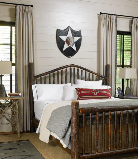 The hickory bed is by Beaver Creek Furniture; the Lowes bought the wall art and red pillow at Timpson Creek Gallery.