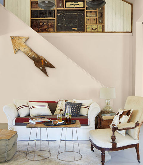 On the hunt for a graphic statement piece, the owners of this Texas cottage came across this midcentury galvanized metal arrow at the Round Top Antiques Fair, and nabbed this albino cowhide at a Houston estate sale.