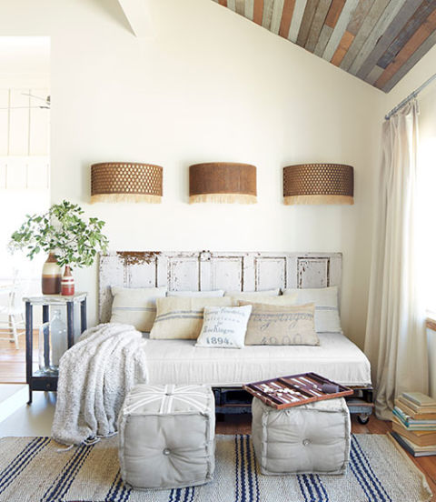 The owner of this Texas home fashioned the frame of the daybed using a $25 flea-market door and pallets. The pillowcases? Old grain sacks, natch.
