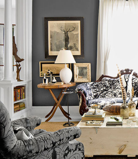 The aesthetic of the upstate New York home of Country Living's editor, Sarah Gray Miller, took shape based on whatever she discovered at antiques shops or her rural auction house: birdcages, floral frogs, Victorian sofas, cryptic portraits. A palette of grays and browns creates a neutral, yet still dramatic, backdrop for the cabinet-of-curiosities vibe.