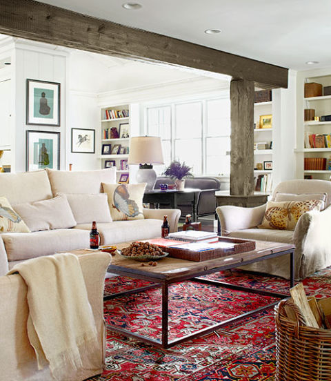 "The owners of this Tennessee home filled in the blanks with new upholstered furniture that wears relaxed, washable slipcovers. Although the family room's Persian rug might look fancy, it secured its prime spot based on practicality. ""The pattern masks spills!"" the owner explains."
