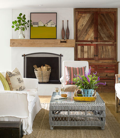 The owner of this California home upgraded her living room's catalog buys, painting a wicker coffee table from Williams-Sonoma in Farrow & Ball's Pavilion Gray and slipcovering the Pottery Barn sofa in French bed linens. She had the cabinet built using salvaged barn wood.