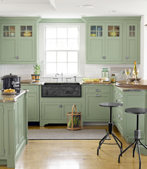 In this Massachusetts beach house kitchen, Wood-Mode cabinetry is painted a color similar to Green Crystal from Olympic. Cape Cod artist Tim Dibble custom-carved the kitchen's slate apron-front sink to incorporate local icons: a windmill, whale, lighthouse, and the word riptide.