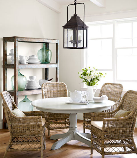 In this California home, fresh paint transformed the dining table, a $100 Craigslist score. The owner bought the wicker chairs and shelving unit, crafted from salvaged elm, at R.J. Imports, a San Juan Capistrano boutique. The table is painted Eucalyptus by Restoration Hardware.