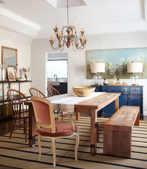 Counterbalance a bold fixture, like the 19th-century Italian chandelier hanging in this California bungalow, by outfitting the room with more understated furnishings.<br />