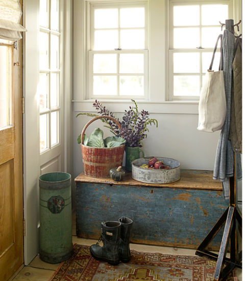 The antique trunk in this quaint Connecticut cottage provides convenient and much needed storage inside the front door, while adding to the rustic atmosphere of the home.
