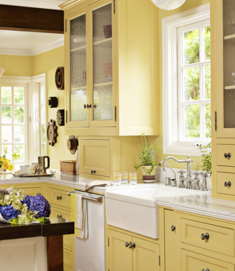 Give a kitchen appeal with a signature color. This bright and cheery California bungalow is awash in Sherwin-Williams's Convivial Yellow. Glass cabinet fronts and white Viking appliances lighten up the space.