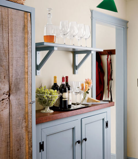 Richard added a pantry bar off the kitchen; a wine cooler is hidden in the cupboard with the old wooden door.
