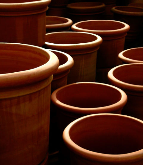 Scour pots with a stiff-bristled brush and rinse. Try to find one with a solid-wood handle and palm fibers.