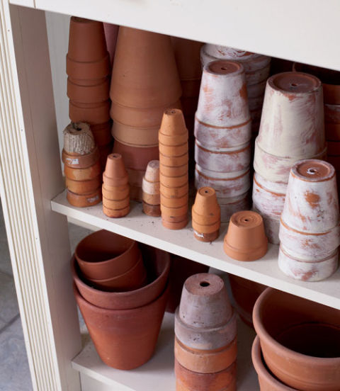 Once clean, turn your terra-cotta pots upside down to prevent them from filling with water, freezing, and cracking. Stack them to save on space.