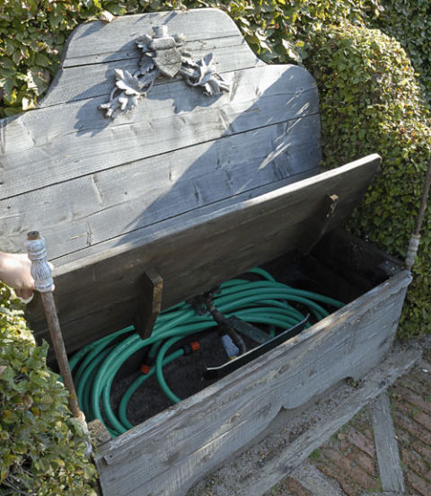 Don't let your garden hose spring a leak! Empty it of water and keep it safe from the elements. (Remember to turn off outdoor water sources.) A hose pot or storage bench helps keep it neat.